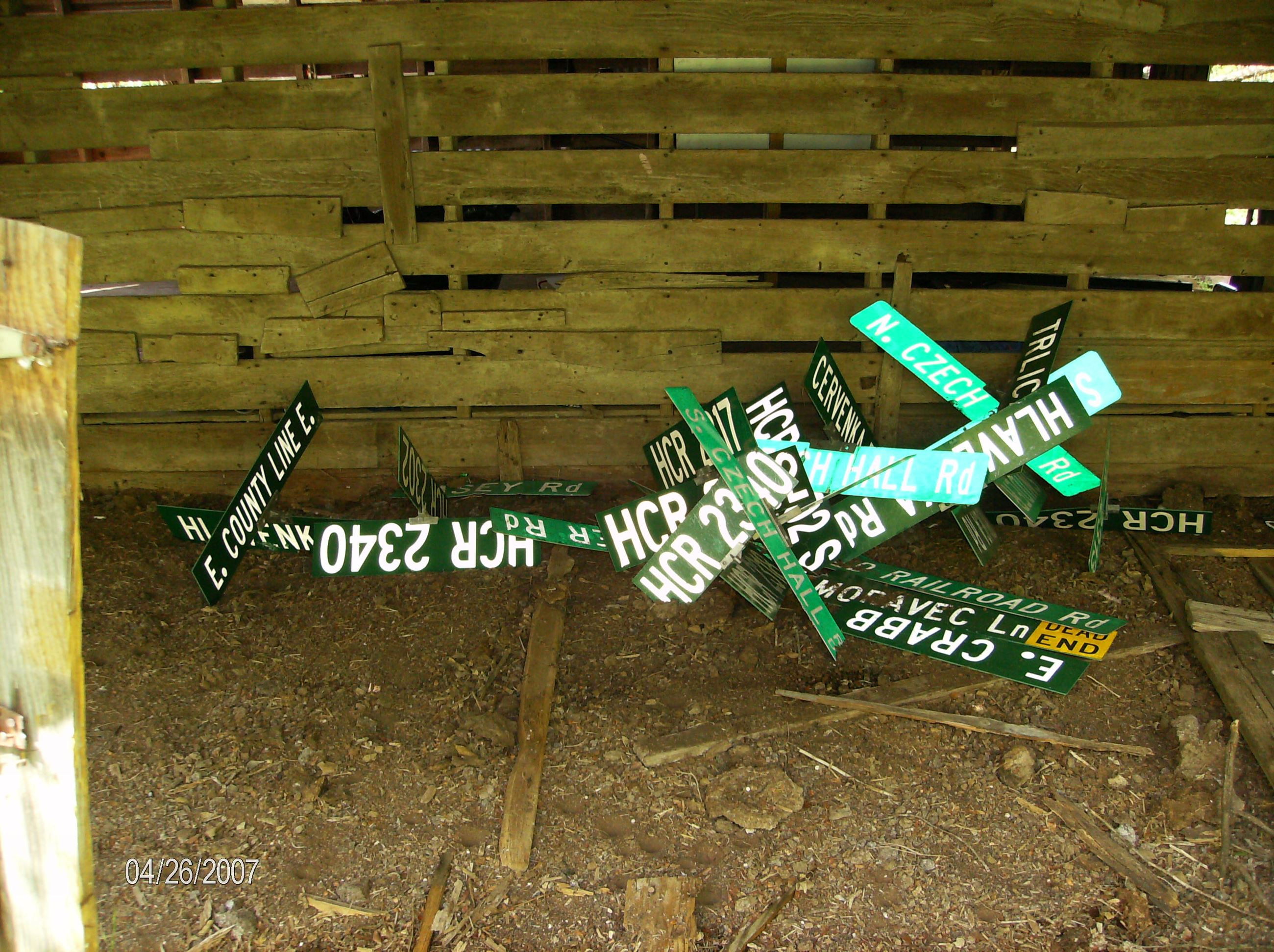 Image Of Stolen Street Sign Stash In Abandoned Building