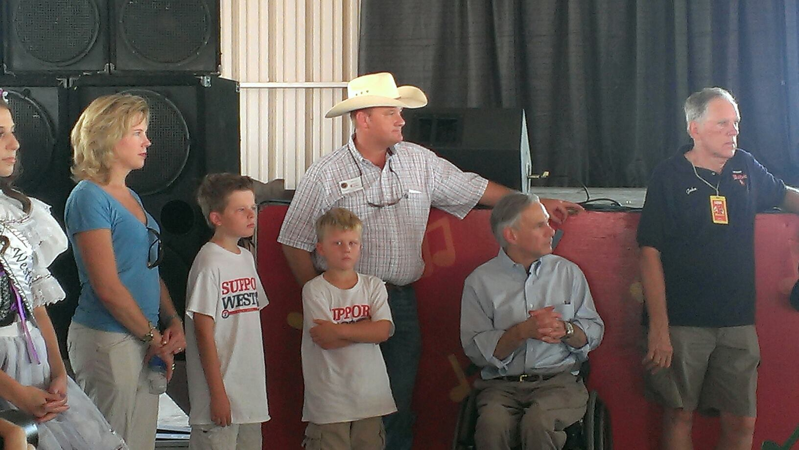 Image of County Commissioner Will Jones, his sons and Governor Greg Abbott