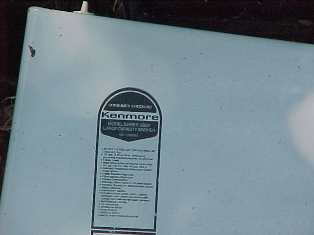 Kenmore sticker on the outside of appliance.