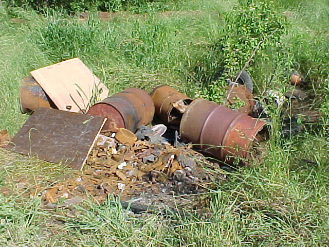 Barrels with electrical components piled