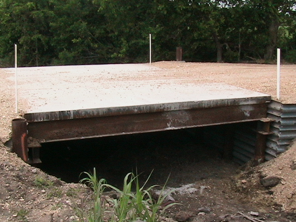 Side view of the bridge so that you can see the top and underneath the bridge