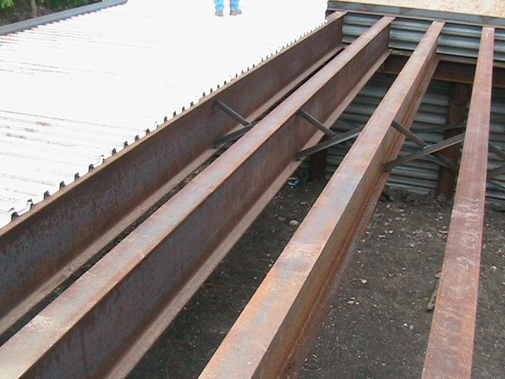 Laying metal sheets across the beams