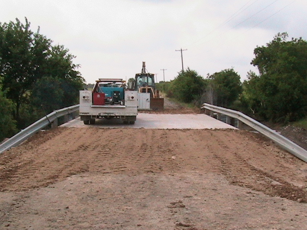 Bridge is complete and the construction crew drove over the bridge