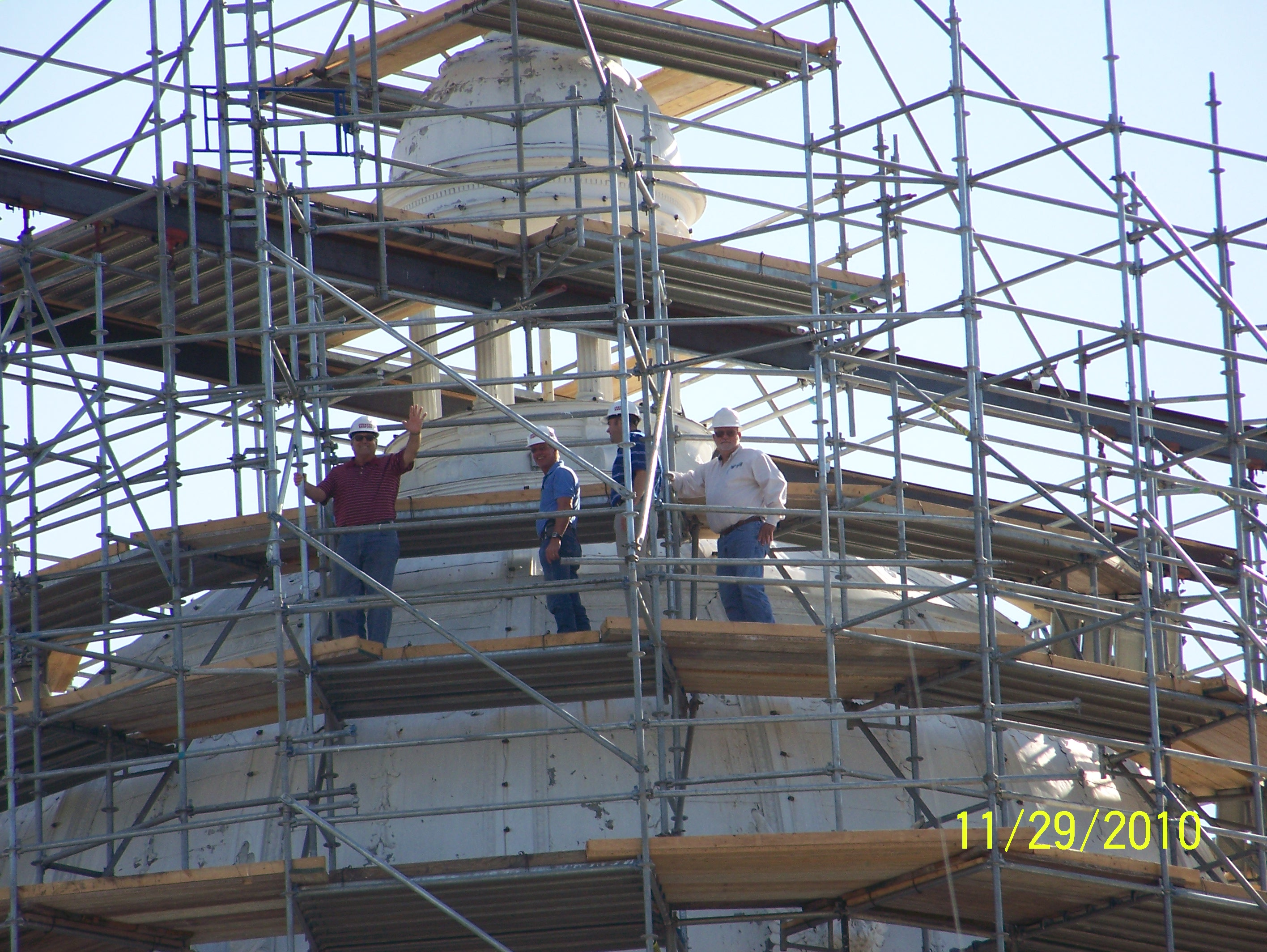 Workers on the Courhouse roof making repairs