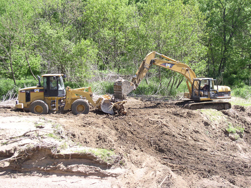 Backhoe working to repair the damage done to Aqullia Creek