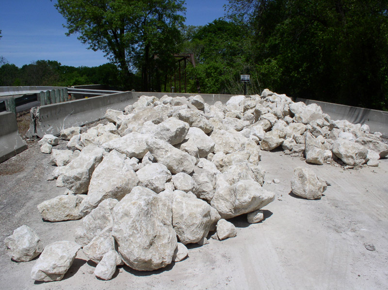 Large white rocks on the road