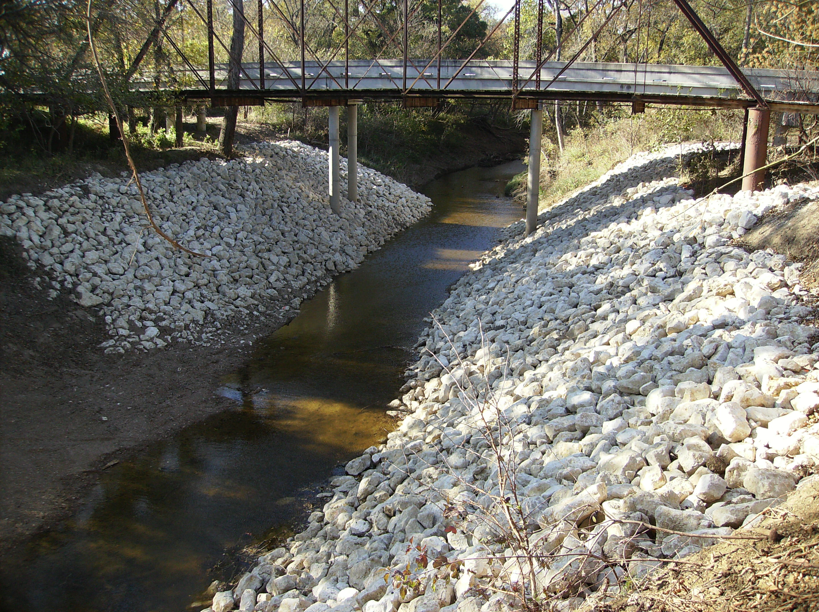Small creek with rock slope walls